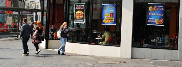 People not looking at point of purchase (POP) on fast food restaurant