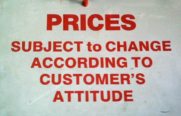 Humorous pricing sign in restaurant.