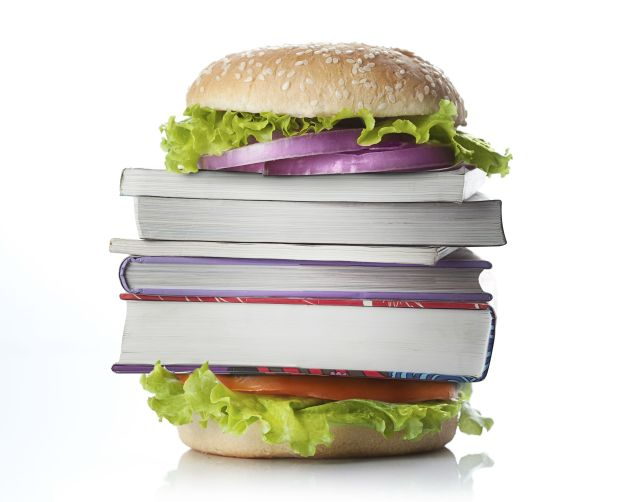 Picture of burger with books in the center of it.